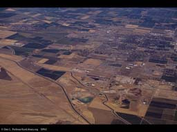 Sprawl and farms, California, aerial