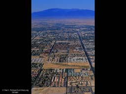 Urbanization to mountains (aerial), Western USA